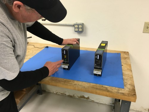 Turbine Aircraft Services employee testing equipment at OKC location